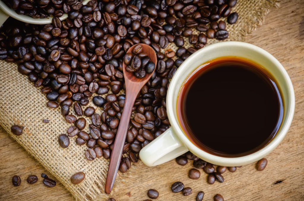 Cup of Americano coffee and coffee beans
