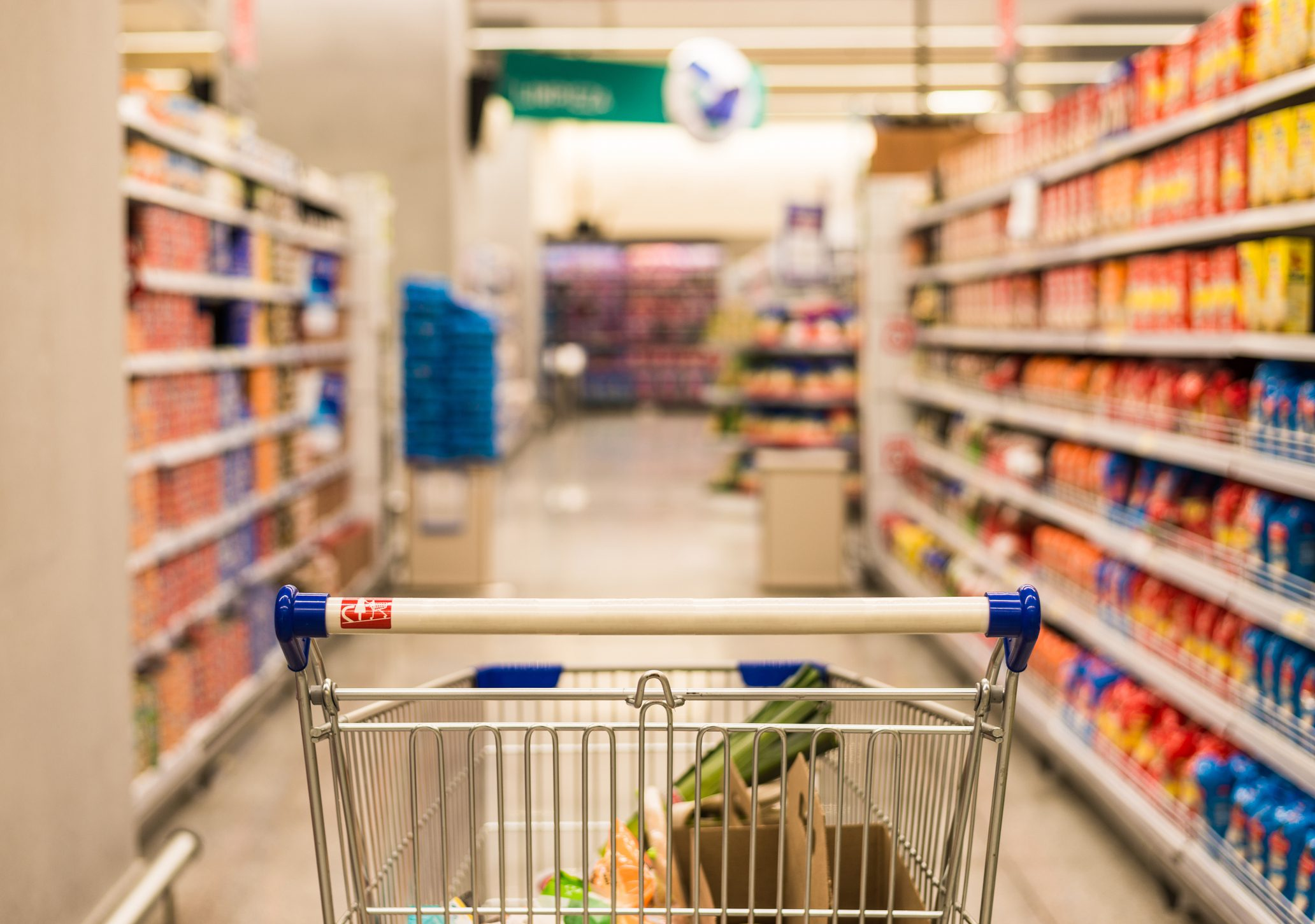 Shopping cart in a supermarket. Shopping, cooking, and price concept.